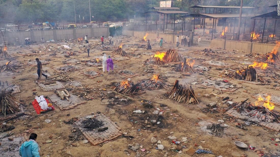As India's crematoriums overflow with Covid victims, pyres burning through the night