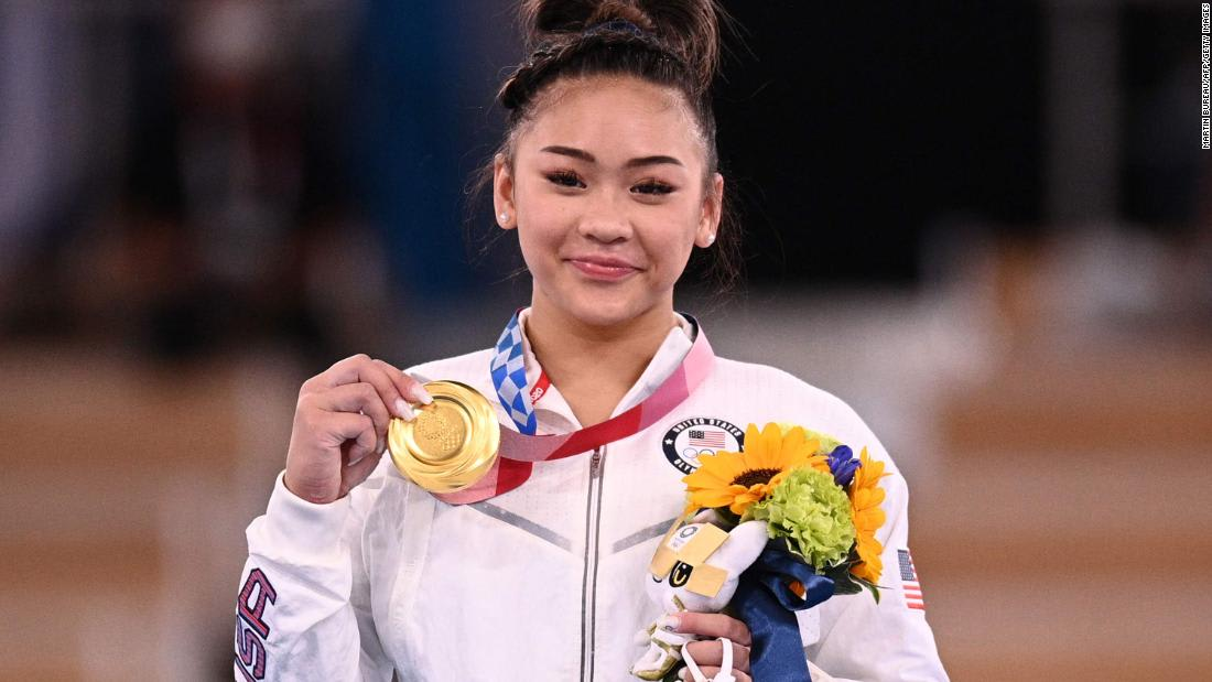 US gymnast Suni Lee wins Olympic all-around after injuries, tragedies and a horrific accident