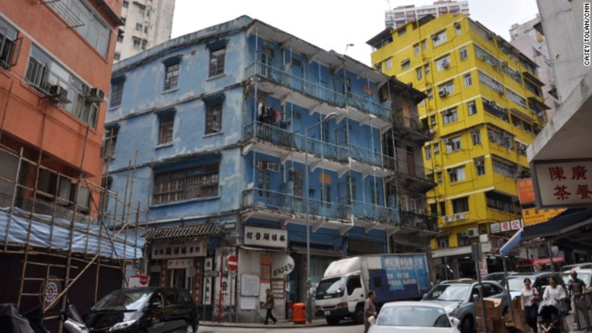 """tenement buildings in hong kong """"in their original form, the tong lau buildings of hong kong were quite primitive living and retail spaces,"""" explains connie lam (tenement buildings."""