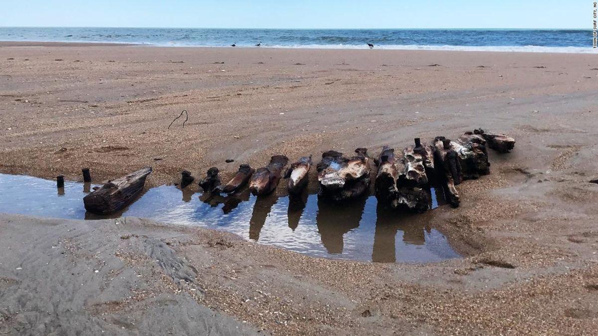 Tides uncover a century-old shipwreck on North Carolina's shore