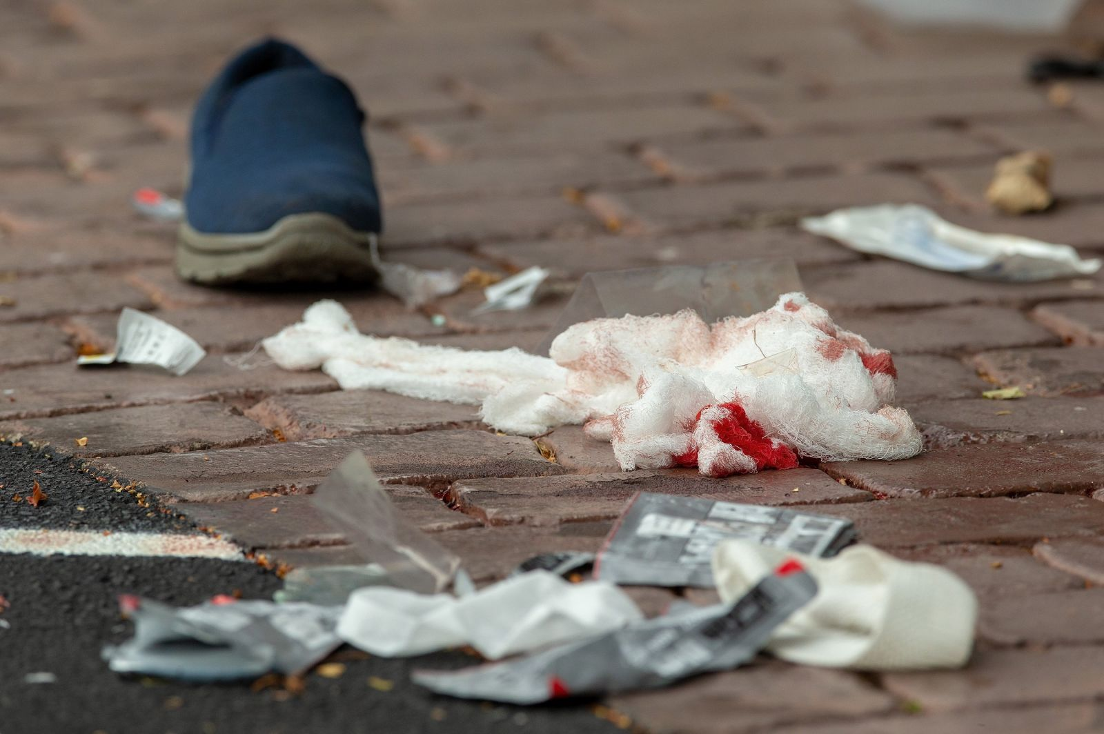 Bloodied bandages litter the road on Deans Avenue.Martin Hunter/EPA