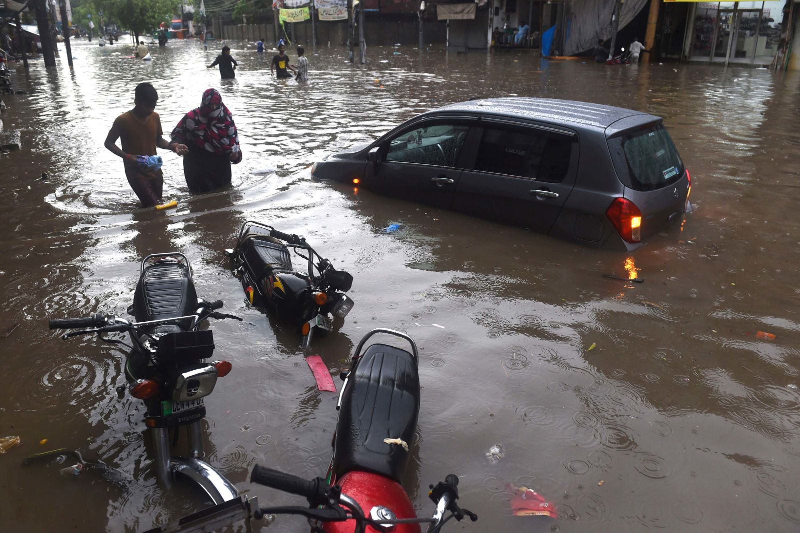 In pictures: Flooding across South Asia kills more than 100