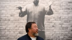 Chinese artist Ai Weiwei poses for photographers during a press preview at the Royal Academy in London on September 15, 2015, ahead of the opening of a major exhibition of his work. The exhibition runs from September 19 to December 13, 2015. AFP PHOTO / LEON NEAL (Photo credit should read LEON NEAL/AFP/Getty Images)