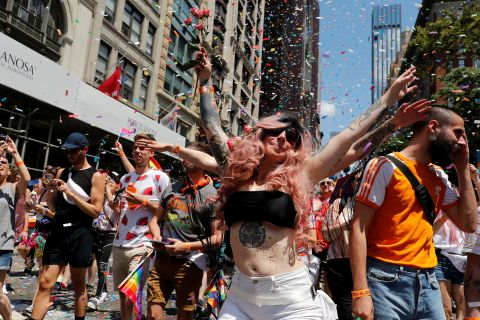 Confetti falls on the marchers as they make their way down the parade route. Jeenah Moon/Reuters