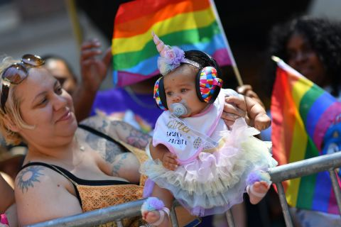 A very young participant watches the parade go by. Angela Weiss/AFP/Getty Images