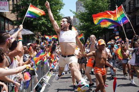 An exuberant marcher leaps in the air during the New York City Pride March. Timothy A. Clary/AFP/Getty Images