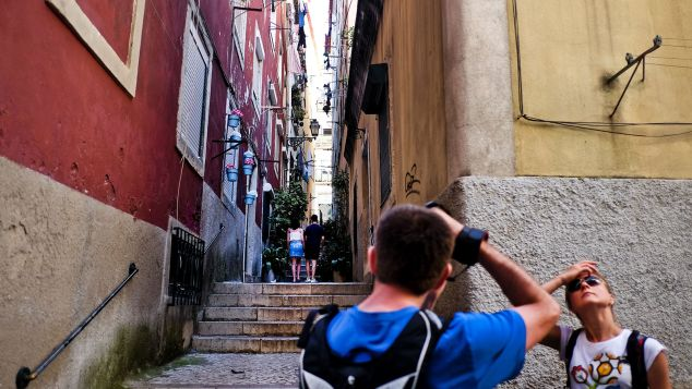 Lisbon's old quarter Alfama has a lighter pastel-colored outlook comparing to Porto's Ribeira area.