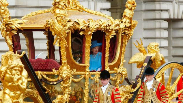 Queen Elizabeth II looks out from the Gold State Coach as she leaves from Buckingham Palace