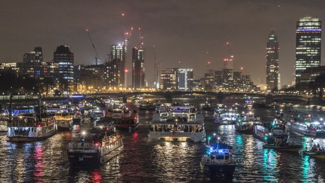 Boats line up in the Thames after watching New Years Eve fireworks in London, England.