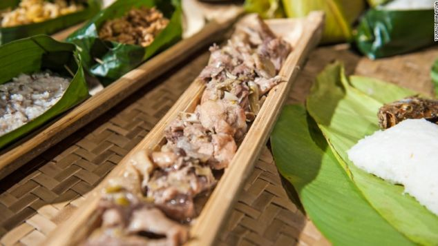 Manok pansoh is cooked inside a long piece of bamboo.