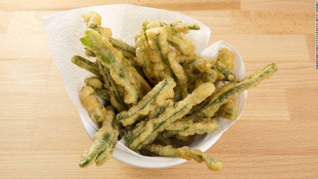 Tasty Green Beans Tempura, also called peixinhos da horta, in a bowl