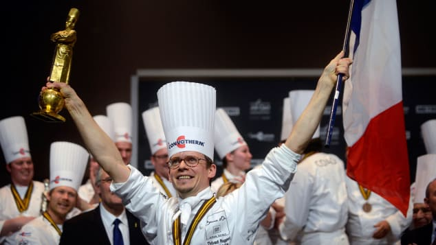 ench chef Thibaut Ruggeri celebrates as he wins the final of the international culinary competition of the Bocuse d'Or in 2013