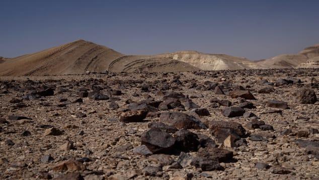 Basalt rocks are scattered across the desert.