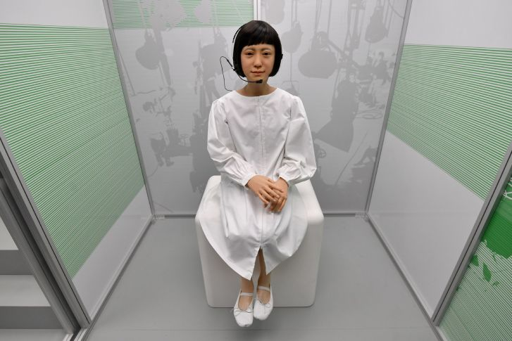 Kodomoroid, designed by Japan's Hiroshi Ishiguro Laboratories, reads the news.