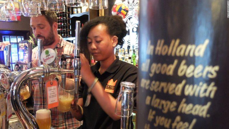 Staff at De Hems pub in London