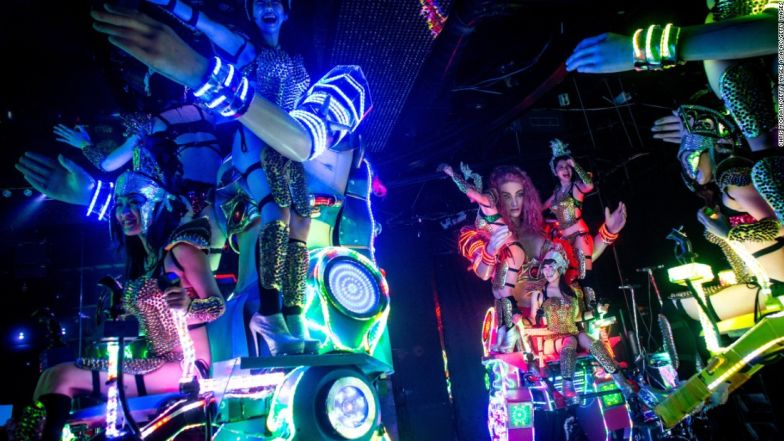 """Dancers perform on large scale """"female"""" robots."""